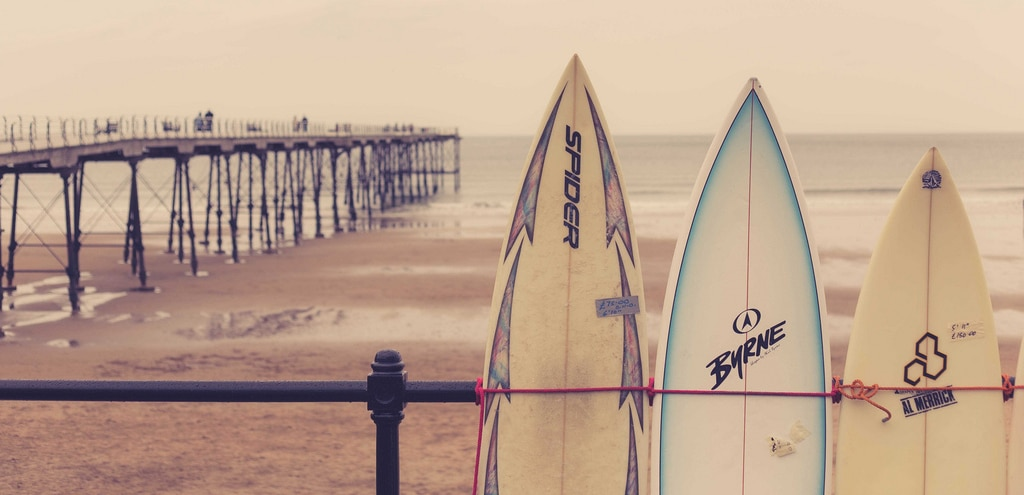 Uniquely Local Gift Experiences - surfboards on Saltburn beach