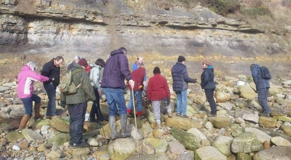 Group dinosaur footprint hunting trip